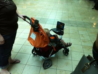 young child watching video in stroller